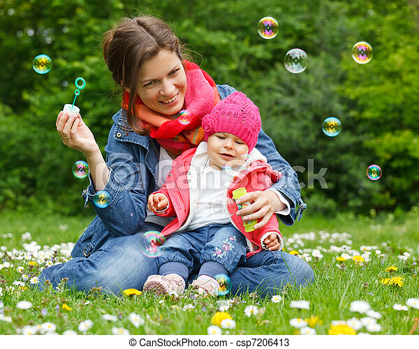 Mother with baby in the park - csp7206413