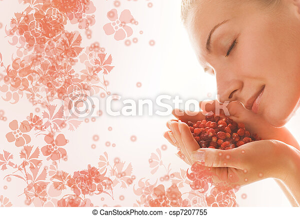 Beautiful girl with a handful of aromatic berries - csp7207755