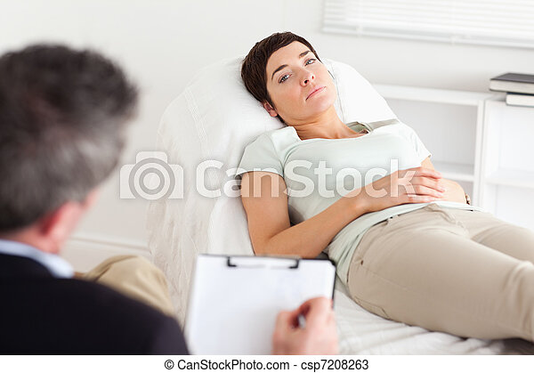 Psychologist talking to a depressed female patient - csp7208263