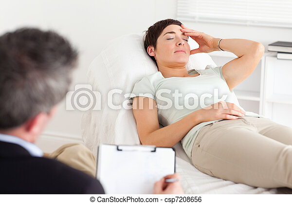 Psychologist talking to a depressed patient - csp7208656