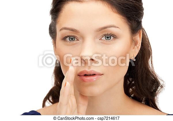 woman whispering gossip - csp7214617
