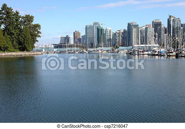 Burrard inlet marina & Vancouver BC skyline. - csp7216047