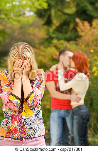 Crying girl and kissing couple on a background