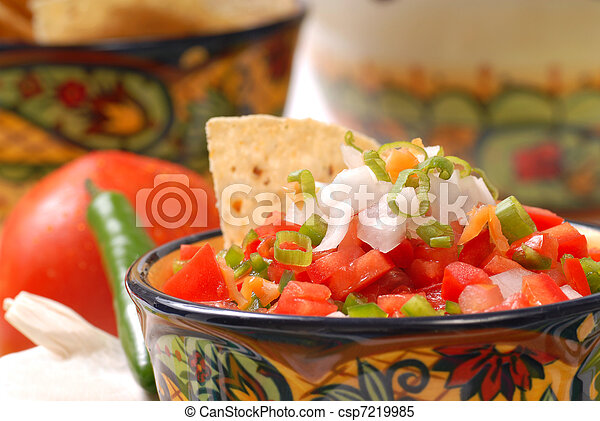 Spicy salsa with tortilla chips - csp7219985