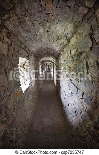 stone corridors in the ruins of an ancient castle - csp7235747
