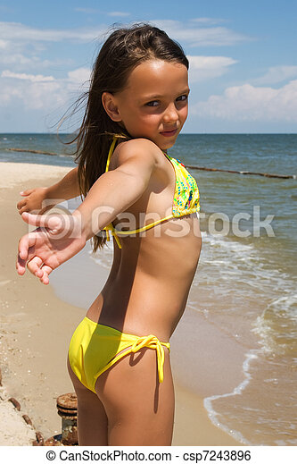 stock image of little girl posing at the seaside   small