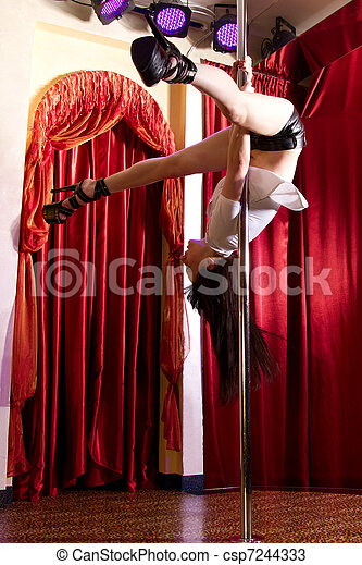 Stripper hanging on pole - csp7244333