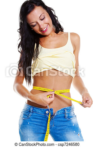Slim woman in jeans with tape measure - csp7246580