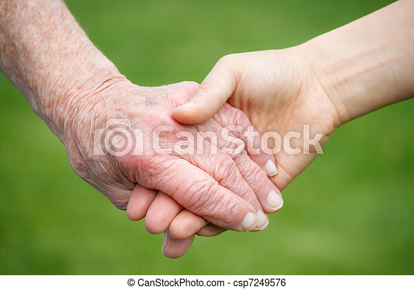 Senior and Young Women Holding Hand - csp7249576