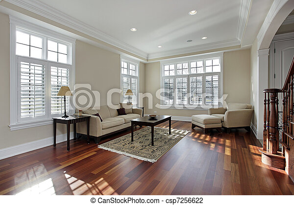 Living room with cherry wood flooring - csp7256622