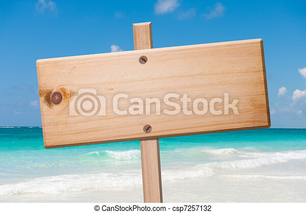 Wood sign in the beach. - csp7257132