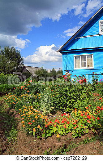 summer flowerses near rural building - csp7262129