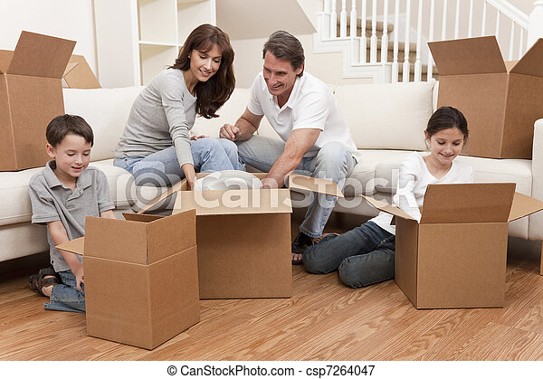 Family Unpacking Boxes Moving House - csp7264047