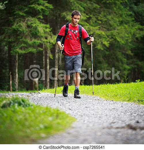 active handsome young man nordic walking - csp7265541