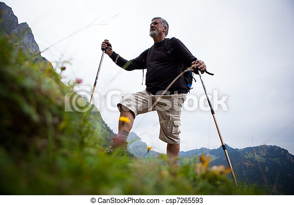 active handsome senior man nordic walking - csp7265593