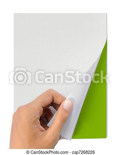 hand turn page of magazine - csp7268226