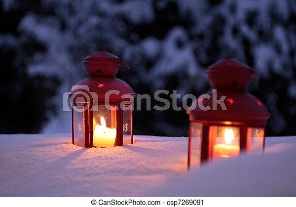 Two burning lanterns in the snow  - csp7269091
