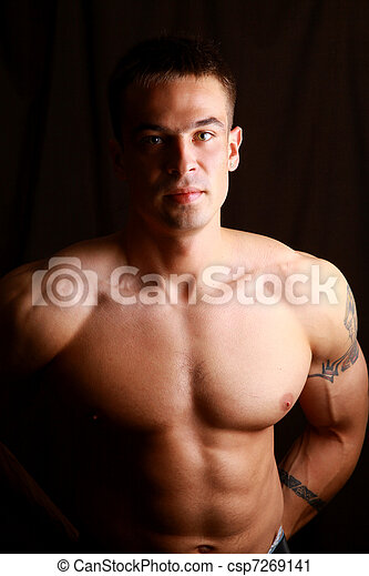 Muscular man with strong arms and nice abs