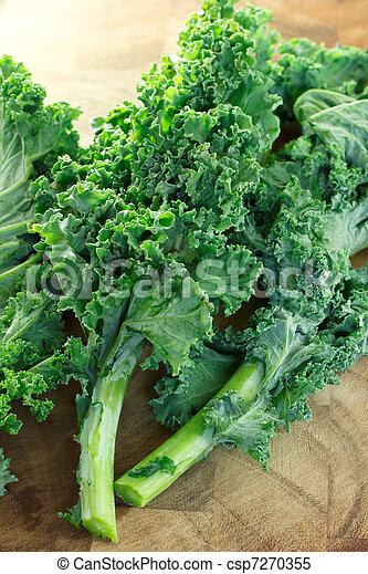 kale on wooden cutting board - csp7270355