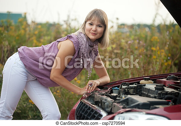 woman trying to fix the car - csp7270594