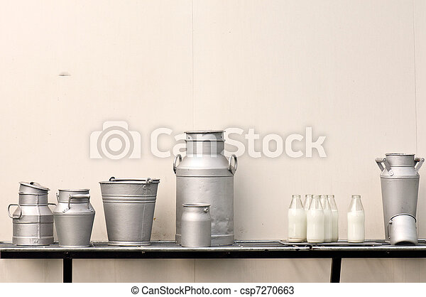 Old milk jugs, cans, bottles and bucket - csp7270663