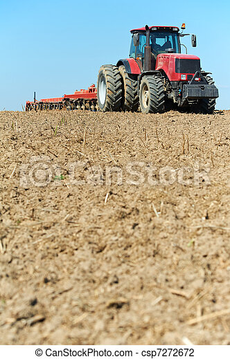 Ploughing tractor at field cultivation work - csp7272672