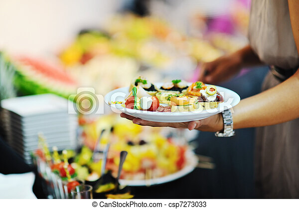 womanl chooses tasty meal in buffet at hotel - csp7273033