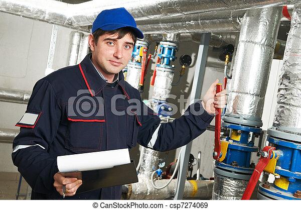 heating engineer repairman in boiler room - csp7274069