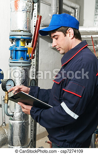 heating engineer repairman in boiler room - csp7274109