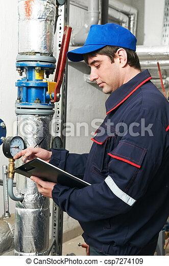 heating engineer repairman in boiler room - csp7274109