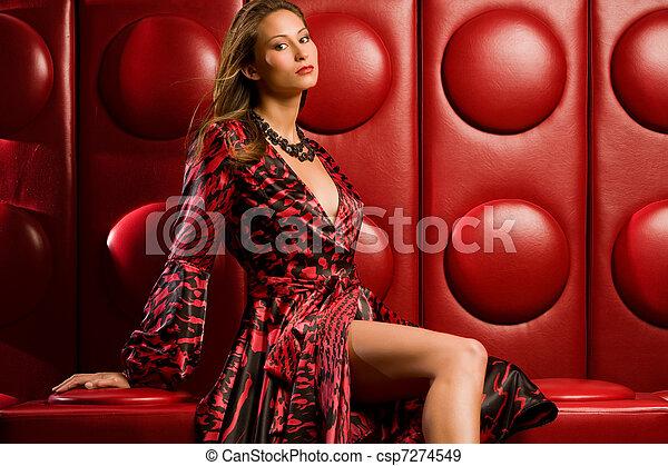 Stock Photographs of Fashion model - Beautiful fashion model sits on funky modern...
