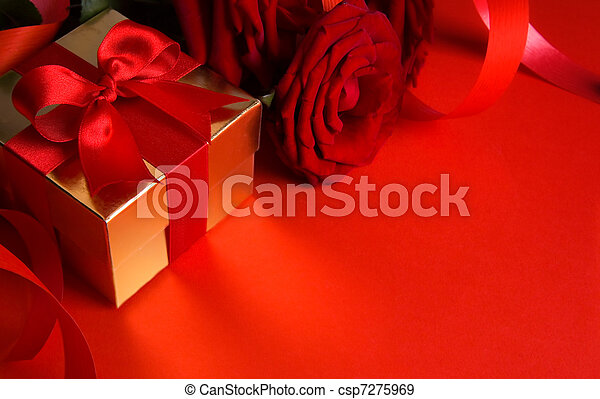 art golden gift box and red roses on a red background - csp7275969