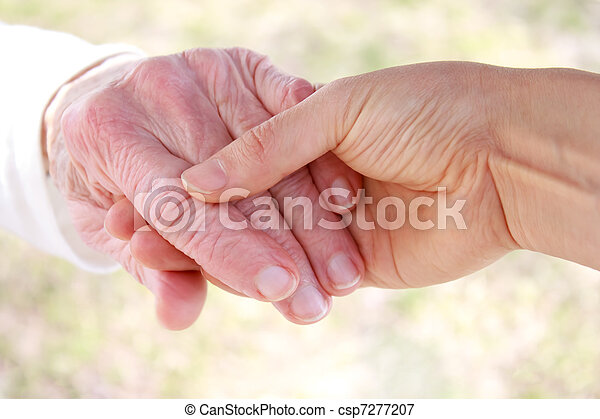 Young holding senior lady's hand - csp7277207