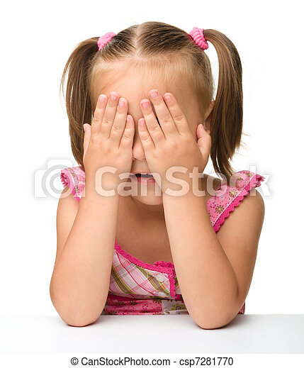 Little girl is playing hide-and-seek - csp7281770