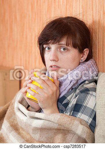 Young illness woman drinking tea  - csp7283517