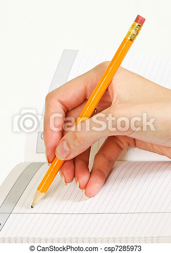 woman writes in a notebook  - csp7285973