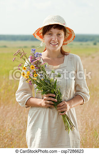 woman with flowers posy - csp7286623