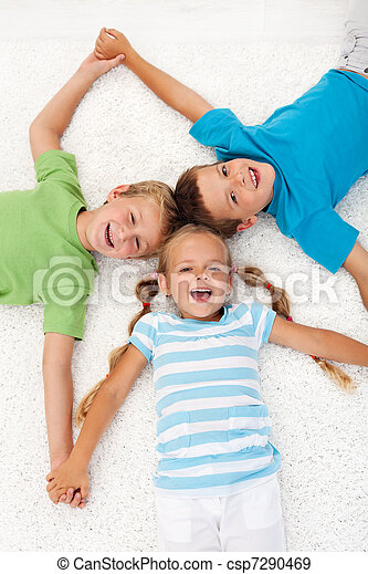Happy laughing kids on the floor - csp7290469