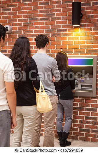 Portrait of people queuing to withdraw cash - csp7294059
