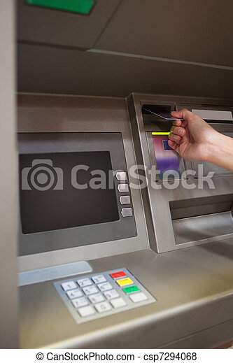 Portrait of a hand inserting a credit card - csp7294068