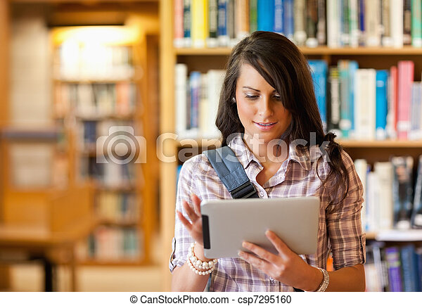 Cute young student using a tablet computer - csp7295160