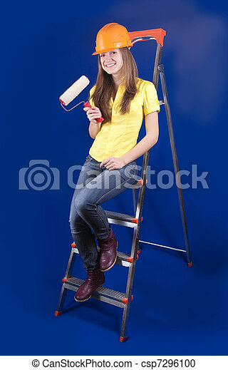 Girl with paint rollers