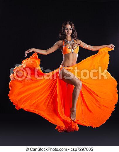 beauty dancer posing in orange veil - arabia style - csp7297805