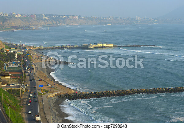 The seaside road in Miraflores and a restaurant built on the pier, with a view on the coastline of Southern Lima in the usual misty weather. The surf breaks are used by many tourists and locals to lea - csp7298243
