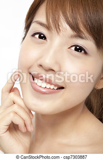 Happy beautiful asian woman's face with fresh clean skin - csp7303887