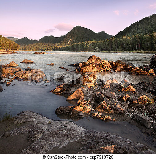 Beautiful evening landscape on the river. Mountain Altai.