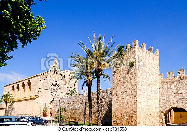 Alcudia Sant Jaume church near roman castle wall Mallorca - csp7315581