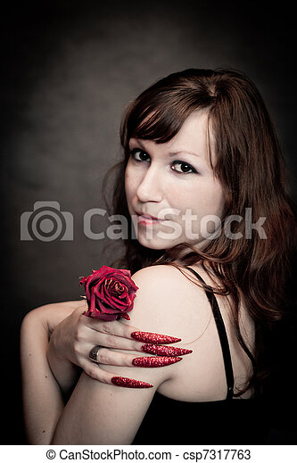 Lady with crimson rose and long nails - csp7317763