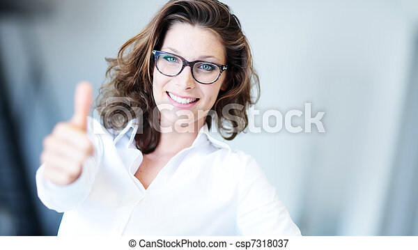 Confident business woman standing wearing elegant clothes with thumb up - csp7318037