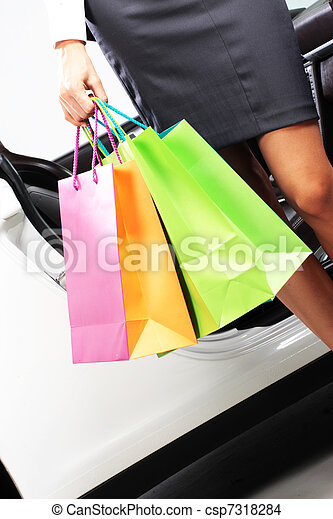 attractive woman in car with shopping bags - csp7318284